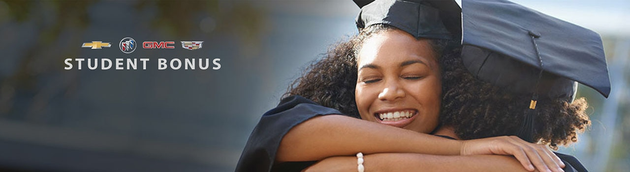 Student hugging her parent after graduating from school.